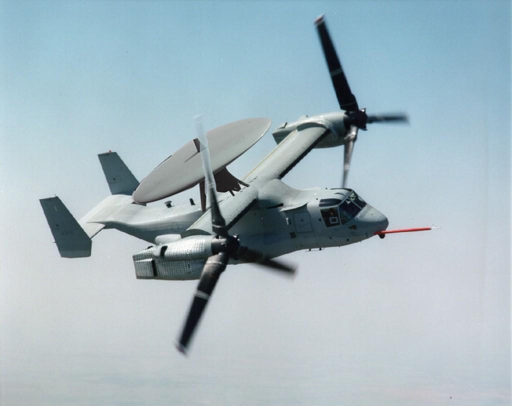 Impresión artística de un MV-22 Osprey con un radar para alerta aérea temprana en la parte superior.